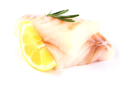 Cod fish fillet with lemon, rosemary on white, isolated photo