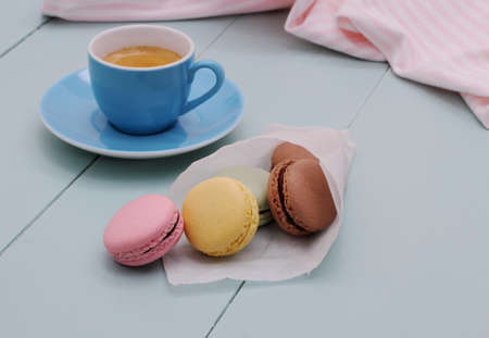 Tracing paper cornet with macarons and Blue Espresso Cup, retro color photo