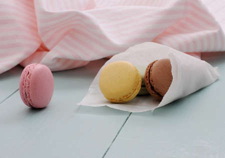 backing up: Macarons in backing paper cornet, close up