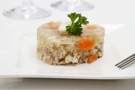 Aspic of chicken with carrots in the form of heart, close up photo