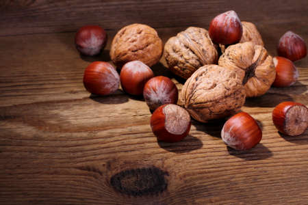Ripe, healthy nuts on wood background, horizontal photo