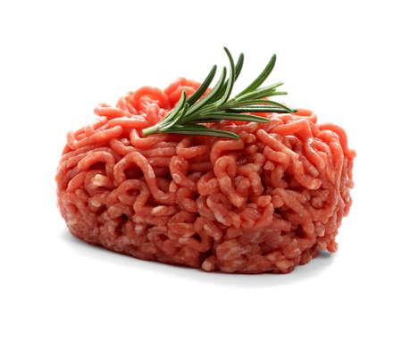 mincing: heap beef minced meat with rosemary, isolated