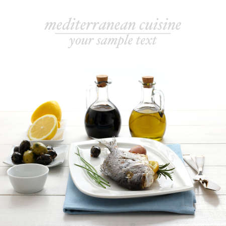 Garnished grilled sea bream with lemon, olives and oil, text space Archivio Fotografico
