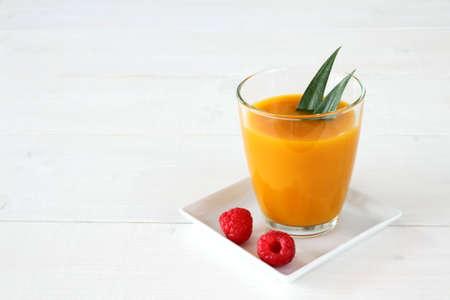 mango: Raspberry, fruity mango smoothie made from ripe fruit, horizontal