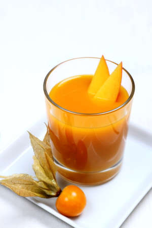 fruity: Fruity mango smoothie with physalis, vertical Stock Photo