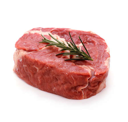 Raw ribeye steak garnished with sprig of rosemary, isolated photo