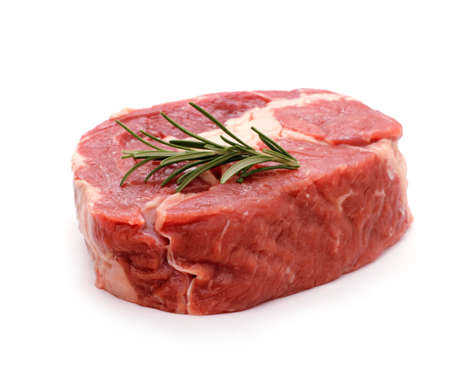 Beef ribeye steak garnished with sprig of rosemary, isolated Stockfoto