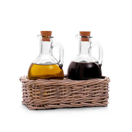 Basket with olive oil, Italian balsamic vinegar of Modena, isolated photo