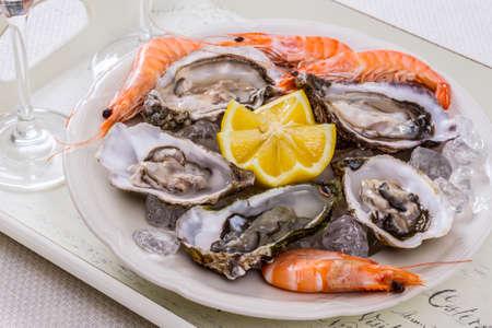 jumbo shrimp: oysters shell jumbo shrimp with lemon on ice top view