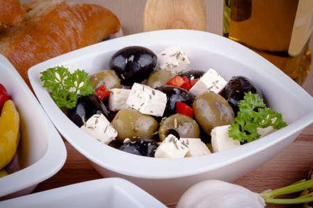 antipasti: Mediterranean antipasti with feta and olive, closeup Stock Photo