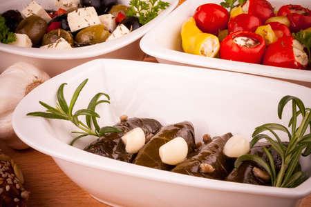 antipasti: Vine leaves stuffed with peppers, Mediterranean antipasti, closeup