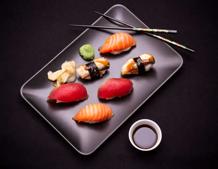 sushi: Eel Salmon and tuna sushi with chopsticks top view