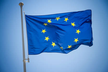 the european economic community: European Union flag on blue sky background
