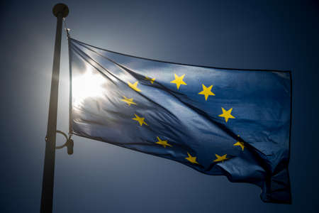 european economic community: European Union flag on blue sky background, backlighting Stock Photo