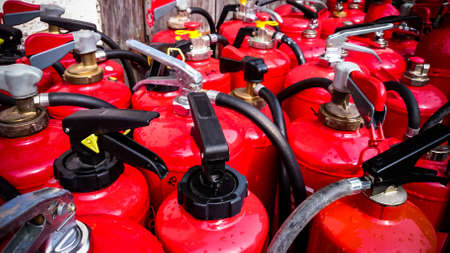 extinguishers: Many used fire extinguishers, top view, as background Stock Photo