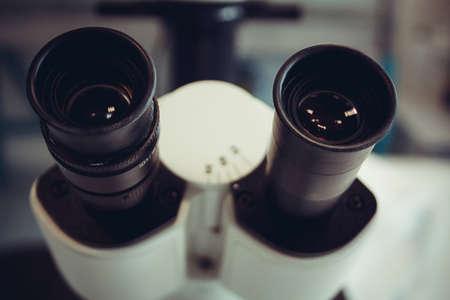 eyepiece: Microscope eyepiece closeup as background, soft focus Stock Photo