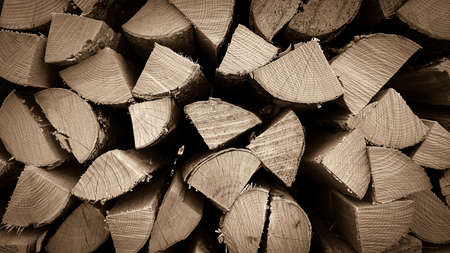 neatly stacked: Neatly stacked wood as background, close up
