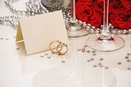 wedding gifts: Wedding rings with writing card and champagne, copyspace Stock Photo