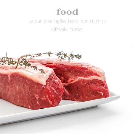 thymine: Fresh rump steaks with thymine twig isolated on white, close up