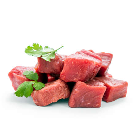 stewing: Pile of juicy beef cubes, macro, soft focus Stock Photo