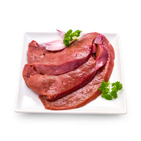 Three raw veal liver slices isolated on white plate, top view