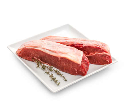 thymine: Fresh rump steaks with thymine twig isolated on white, top view Stock Photo