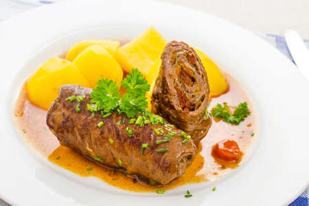 Sliced roulades beef with vegetable filling, potato close up Standard-Bild