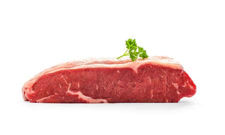 rump steak: Raw rump steak with parsley twig isolated on white