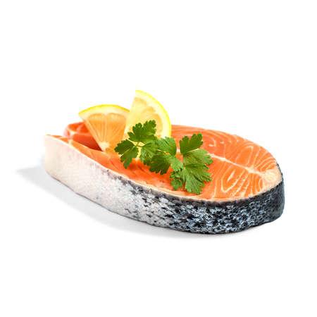 isoliert: Salmon steak with lemon slice and parsley, isoliert Stock Photo