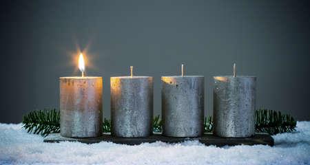 Light four advents candles with matches Foto de archivo