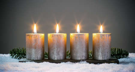 Light four advents candles with matches Archivio Fotografico
