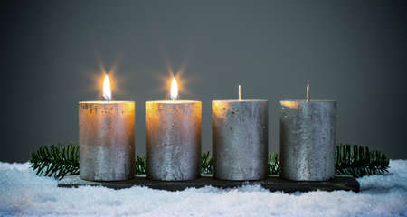 Light four advents candles with matches 스톡 콘텐츠