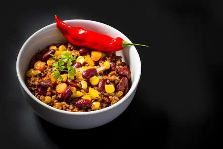 con: Chili con Carne on black, top view