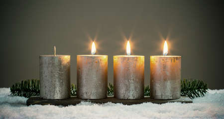 Light four advents candles with matches 版權商用圖片