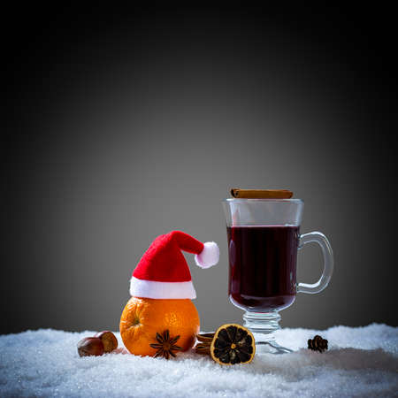 Mulled wine glass on snow, close up Stock Photo