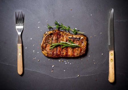 Grilled calfs cutlet with cutlery, top view Stock Photo
