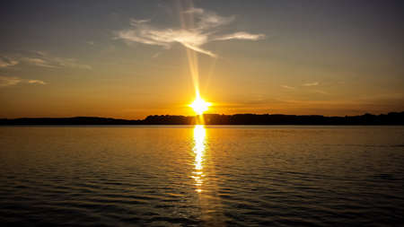 Sunset at lake Starnberger See with silhouettes Stock Photo
