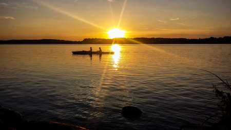 Sunset at lake Starnberger See with silhouettes Love couple
