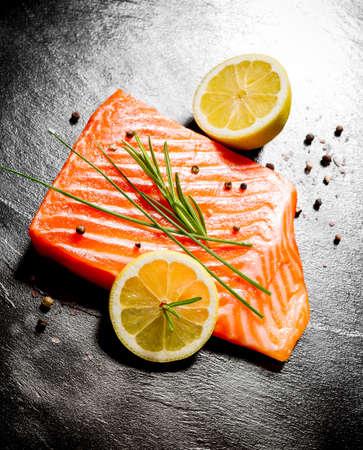 Juicy salmon fillet on black slate plate, top view