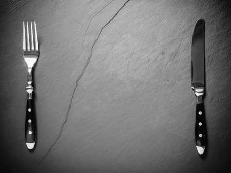 Black slate plate with steak cutlery, place for text, top view Stock fotó