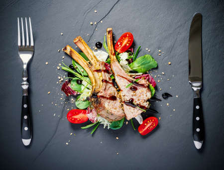 Grilled rack of lamb on slate plate, top view Stock fotó - 129176469