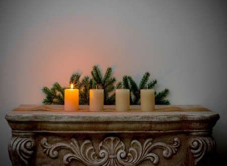 Four Advent candles on fireplace, first Advent Stock Photo