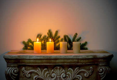 Four Advent candles on fireplace, second Advent