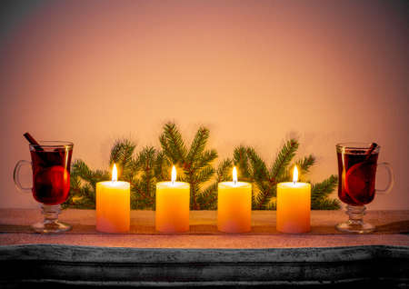Four Advent candles on fireplace, Christmas time