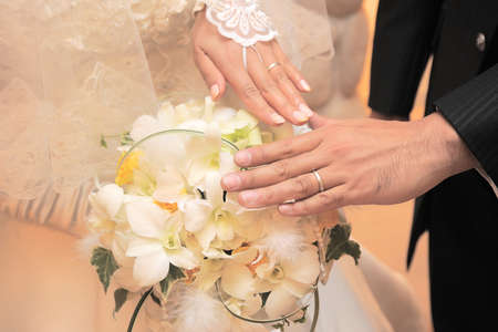 ring up: Hand wedding ring up scene of bride and groom of your joy of in Chapel Archivio Fotografico