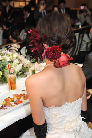 venue: Wedding reception, exactly climax full of the venue now, the bride of back style is ornate representation