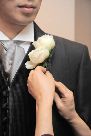 corsage: Manly corsage, somewhat nervous of your appearance that is decorated to the grooms neck Stock Photo