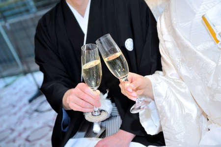 receptions: Very auspicious toast scene filled champagne glasses groom bride