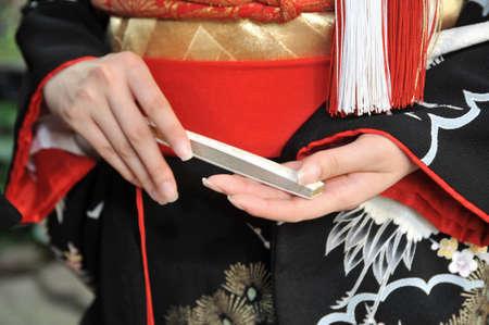 adjournment: Bride of color adjournment, kimono accessories sense very elegant at hand Stock Photo