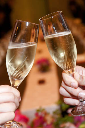 Toast champagne glass in appreciation of toast scene in the wedding reception